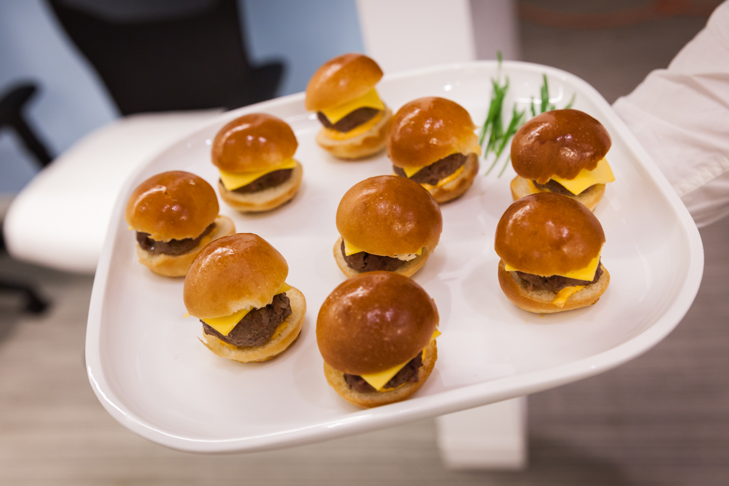 Plate of mini hamburgers served at cocktail party