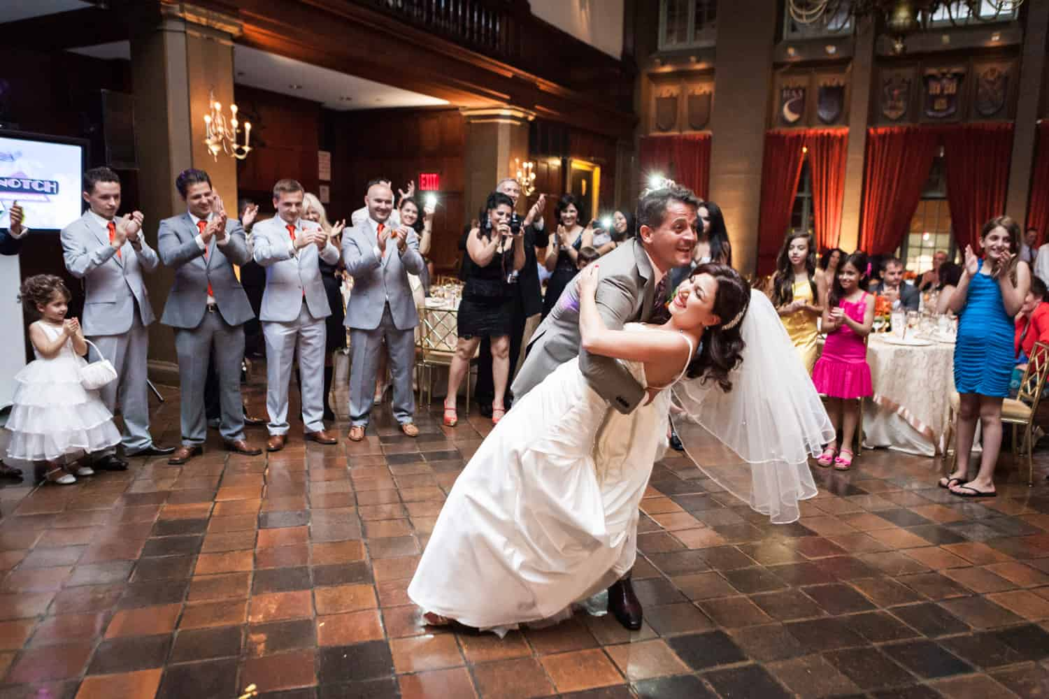 Groom dipping bride during first dance at a Harvard Club wedding