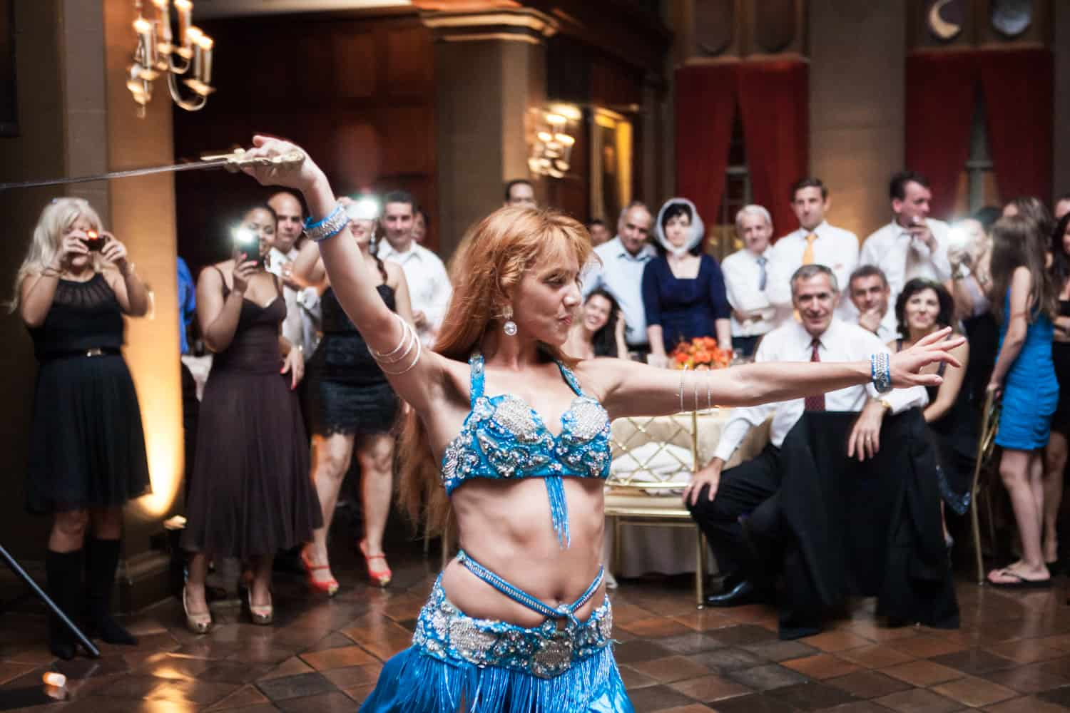 Belly dancer swinging sword at a Harvard Club wedding