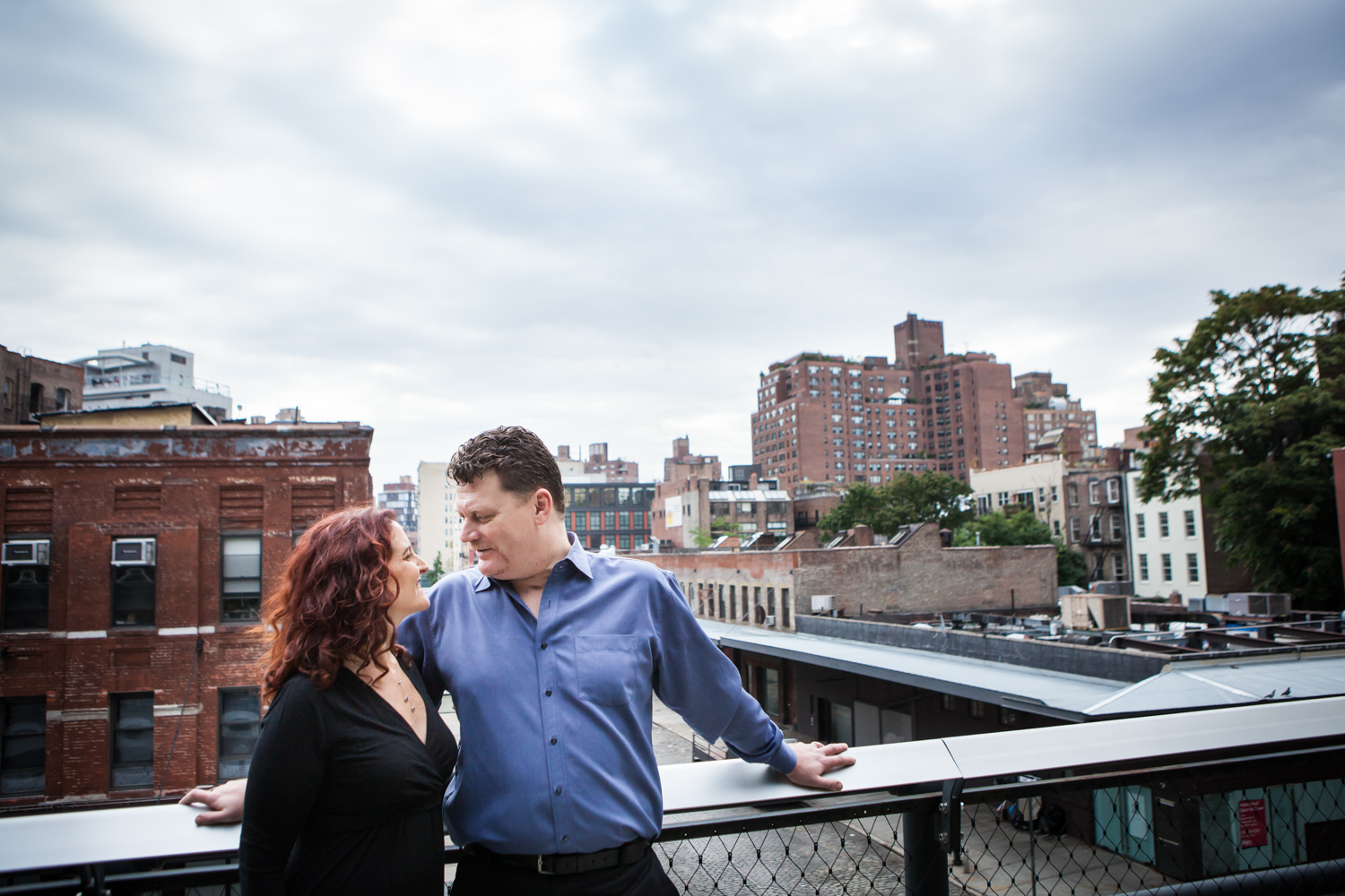 High Line engagement photos of couple with view of Meatpacking District in the background