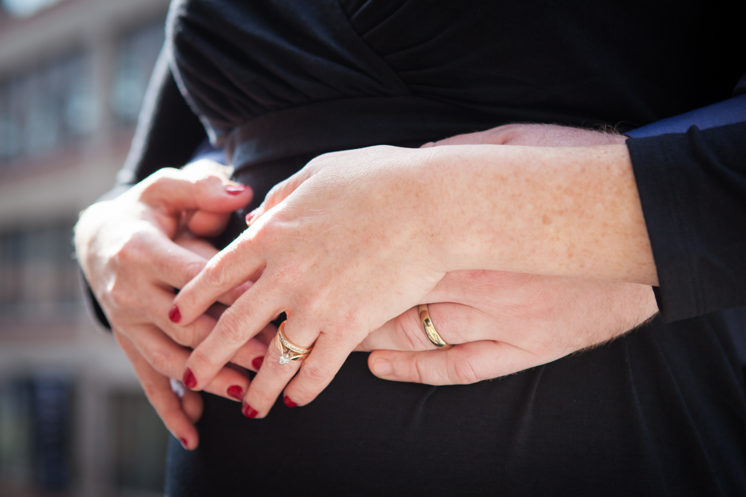 Close up on couple's hands with rings