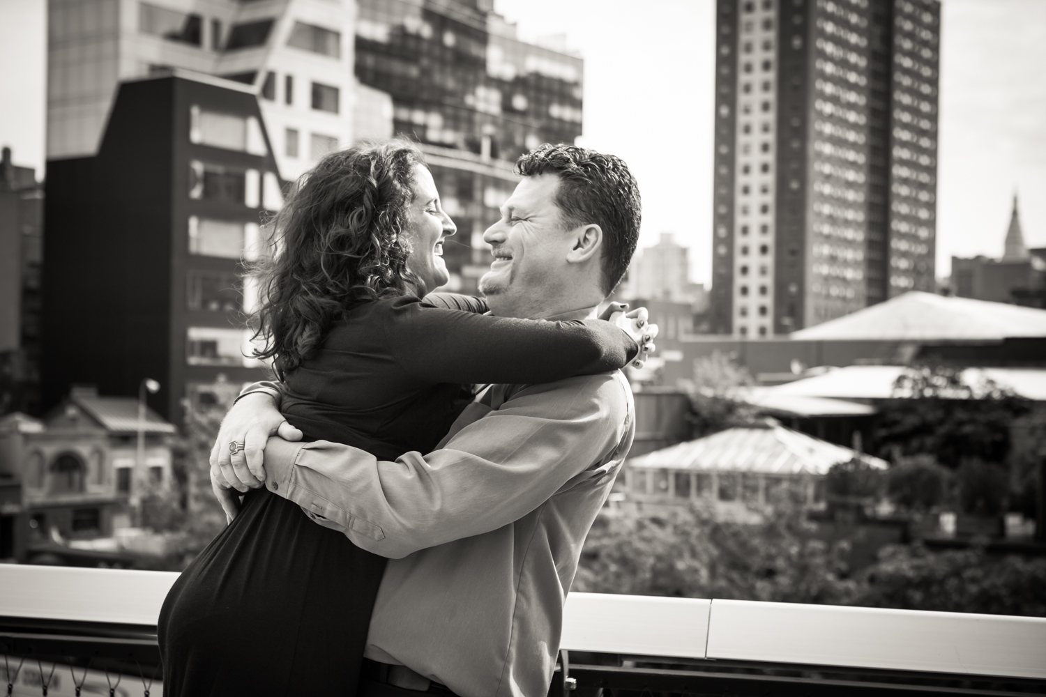 Black and white photo of man lifting up woman on the High Line