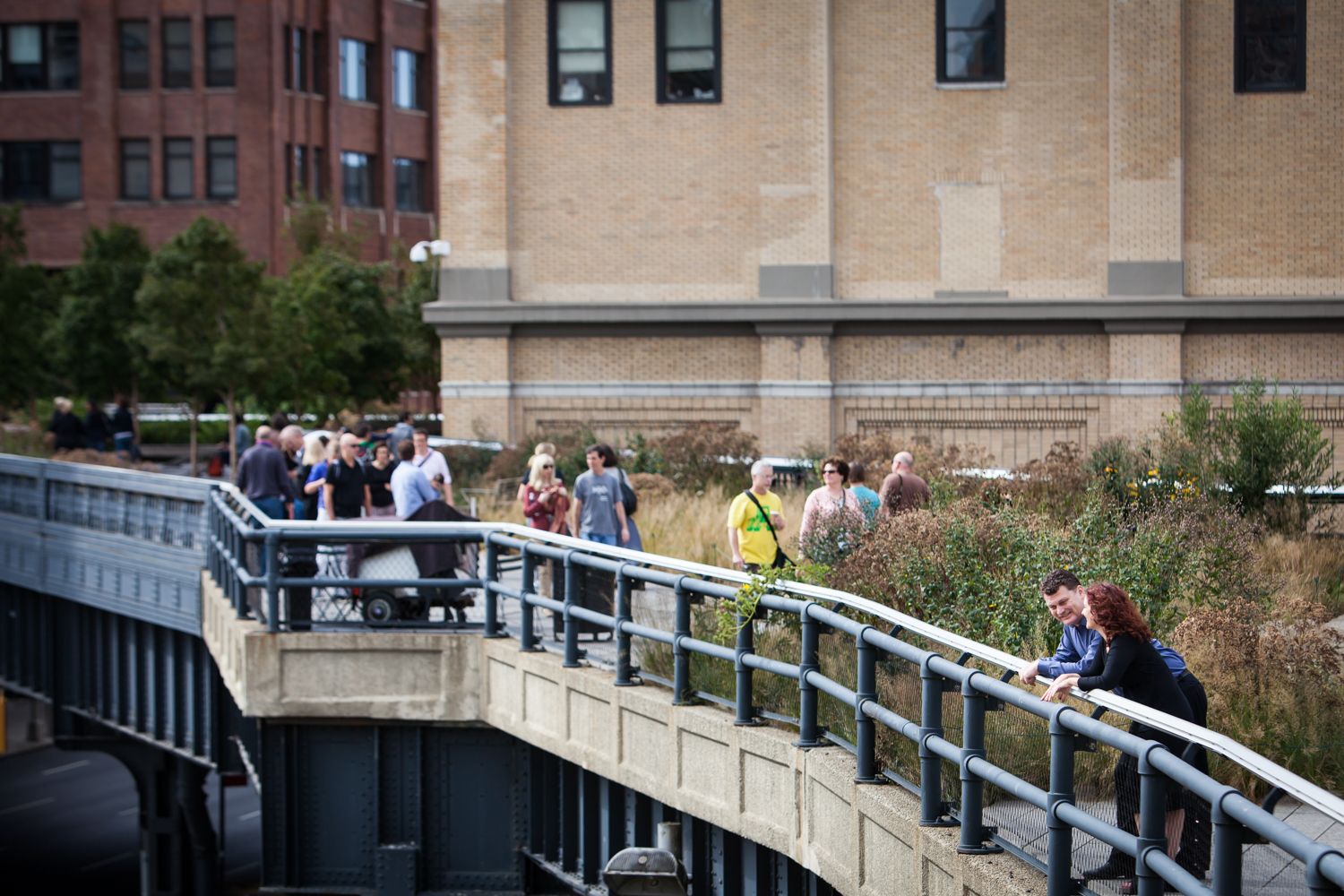 Wide shot of couple leaning on railing of High Line