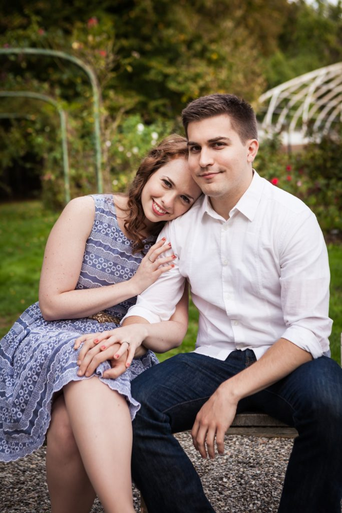 Couple sitting on bench at a Lyndhurst Mansion engagement photoshoot