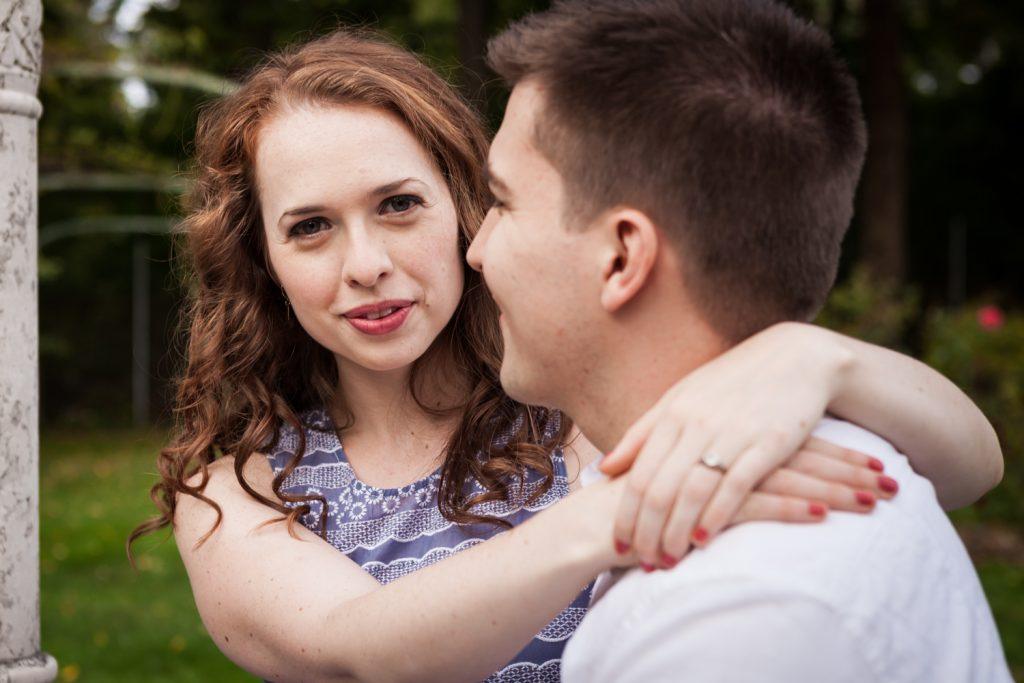 Woman hugging man at a Lyndhurst Mansion engagement photoshoot