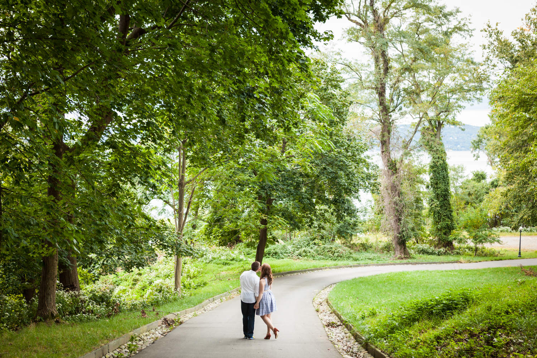 Wide shot of couple walking down pathway at Lyndhurst Mansion garden