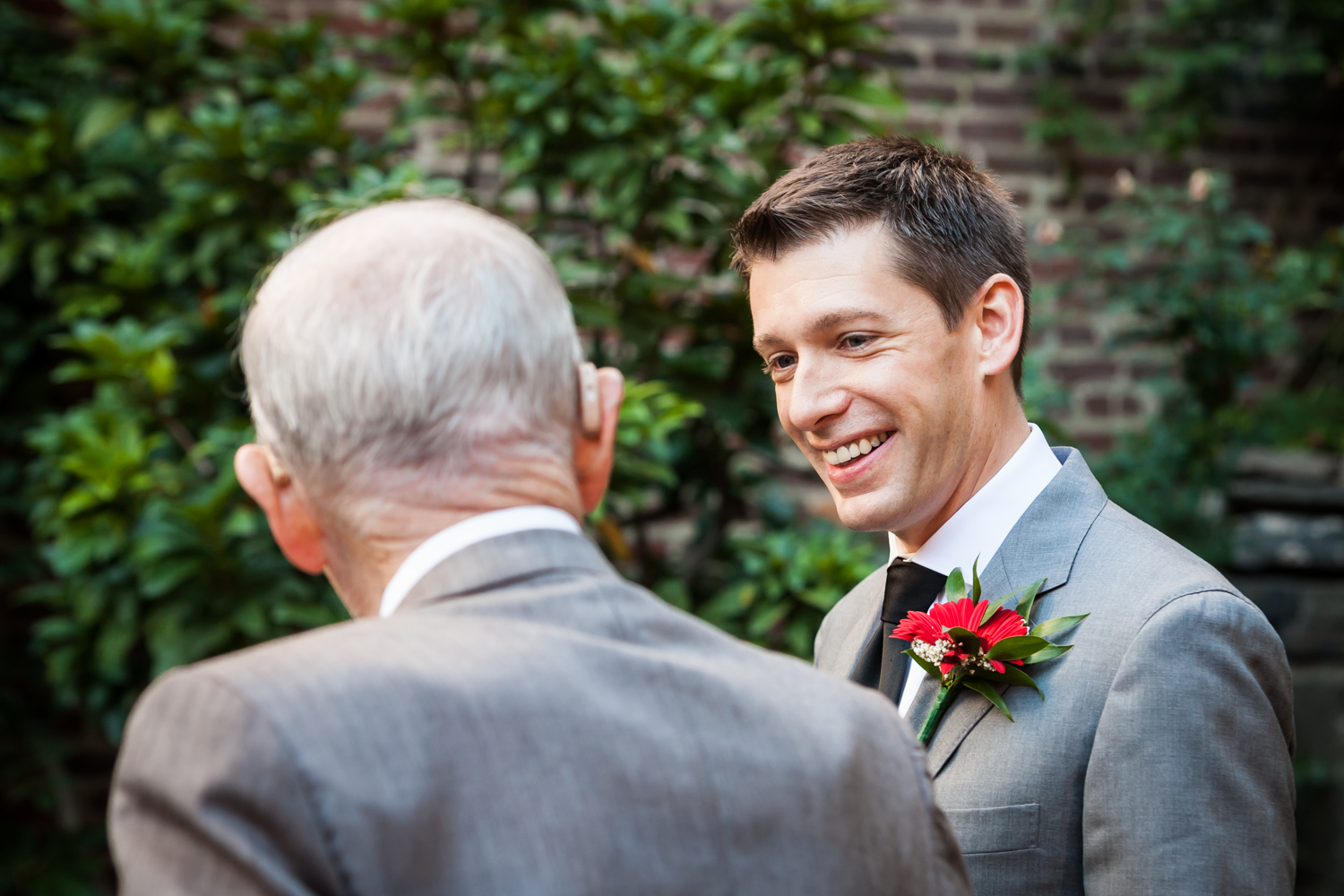 Merchant's House Museum wedding photos of groom smiling at grandfather