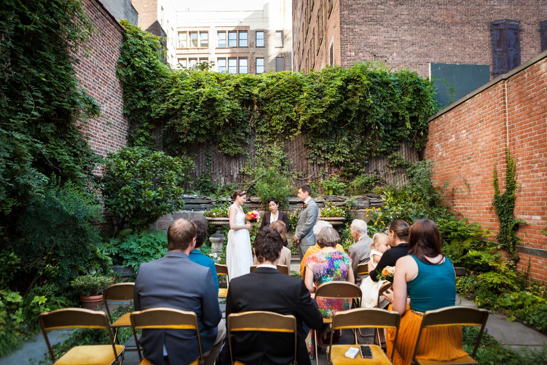 Merchant's House Museum wedding photos of ceremony in walled garden