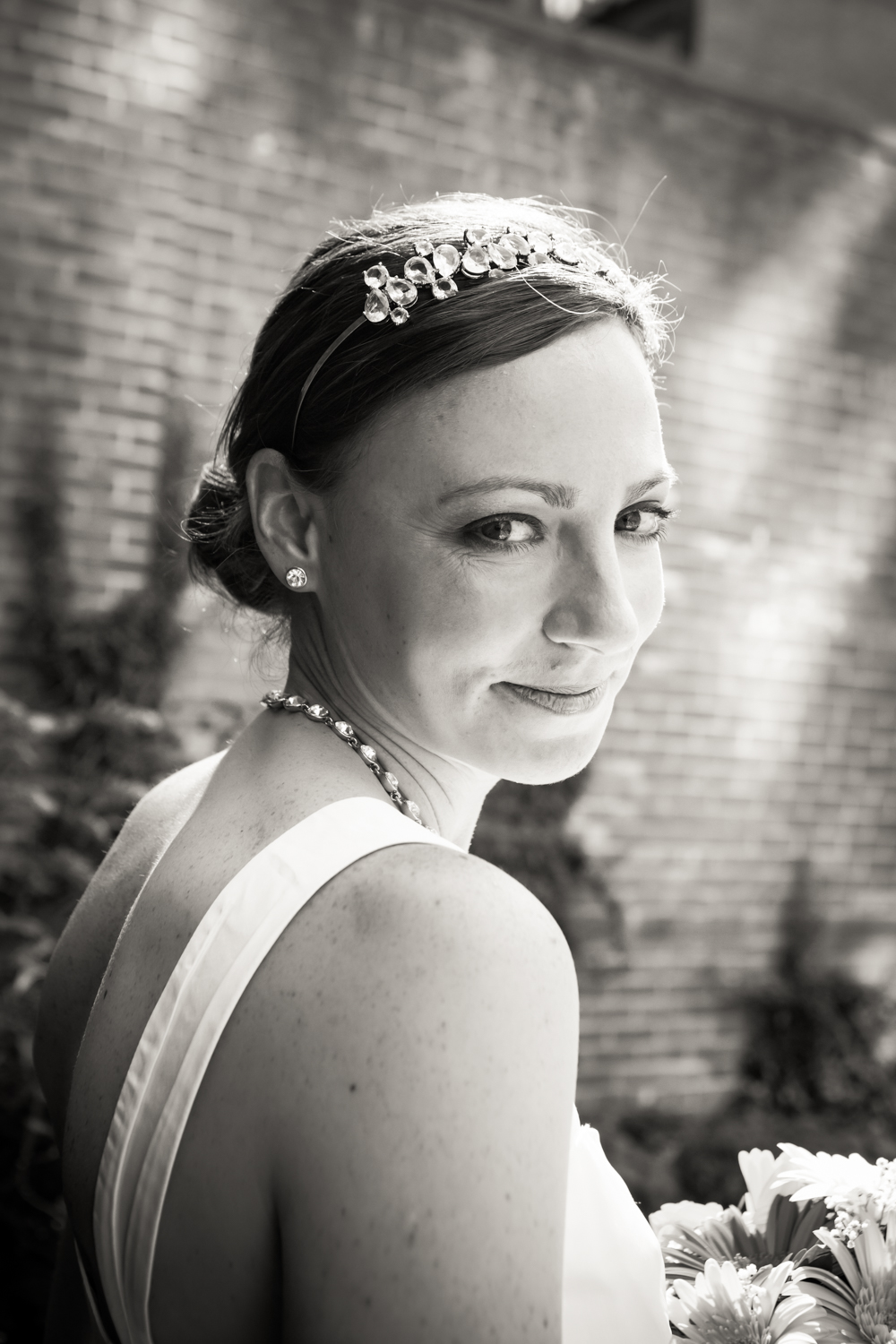 Black and white portrait of bride with hair in bun