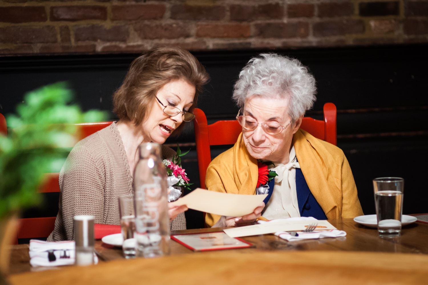 Mother and grandmother looking at menu at Tribeca reception