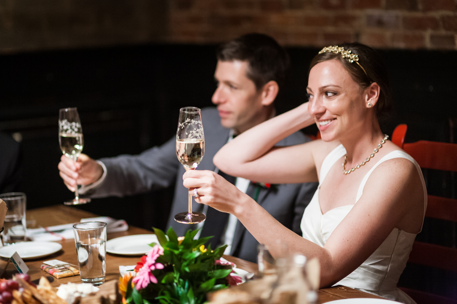 Bride and groom toasting with champagne glasses at Tribeca reception