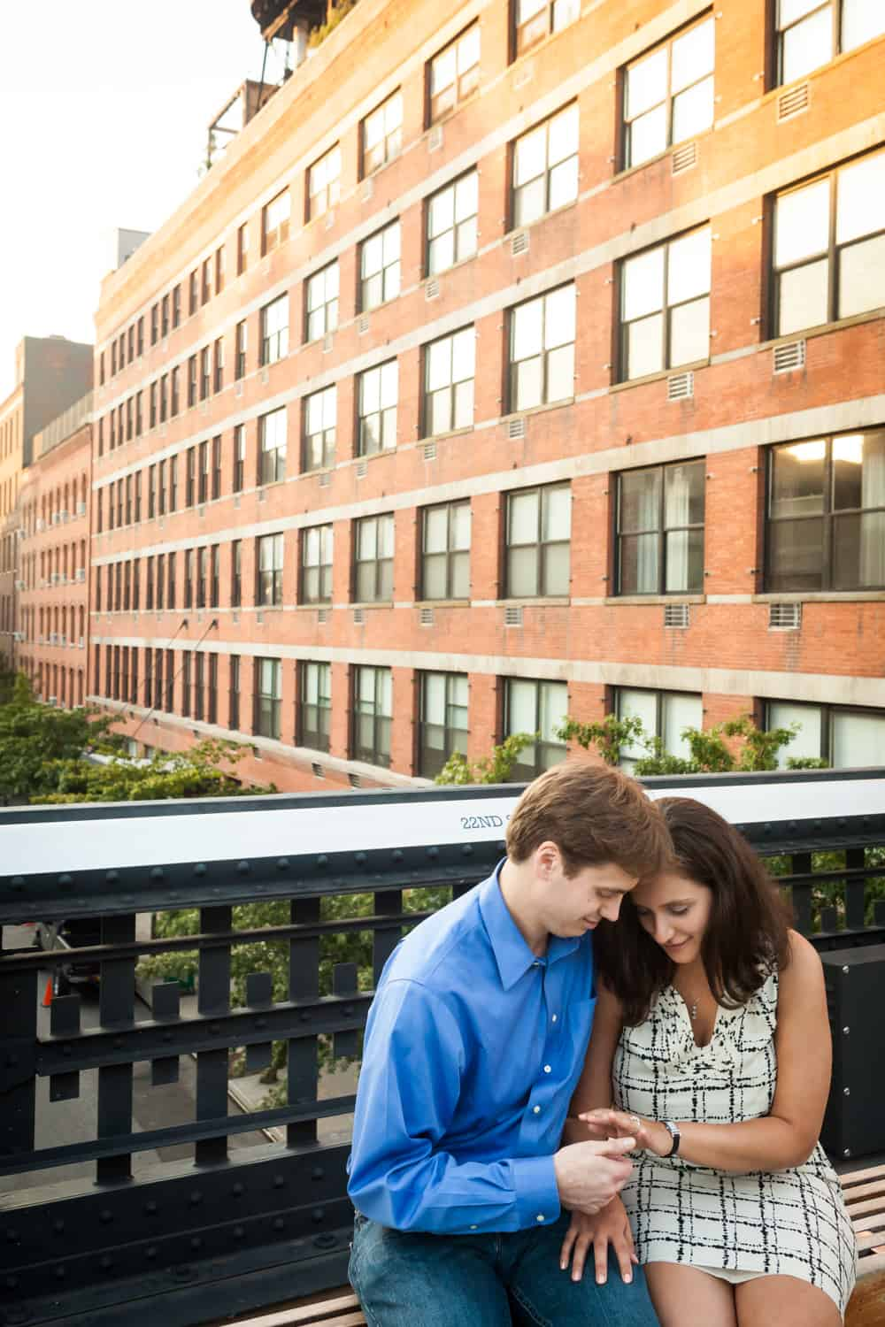 Couple looking down at engagement ring during High Line engagement session