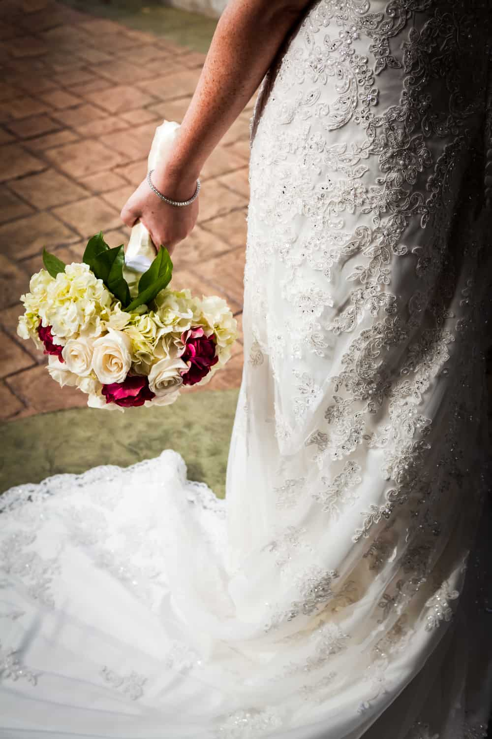 Close up on bride holding bouquet