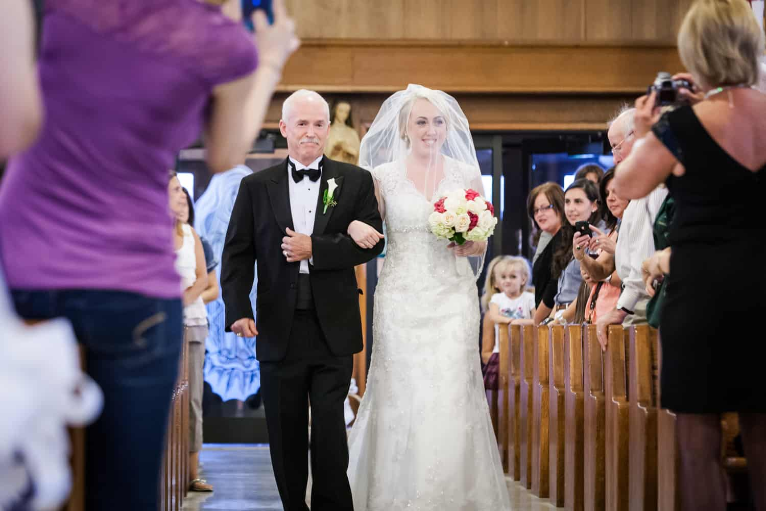 Bride and father walking down aisle for ceremony