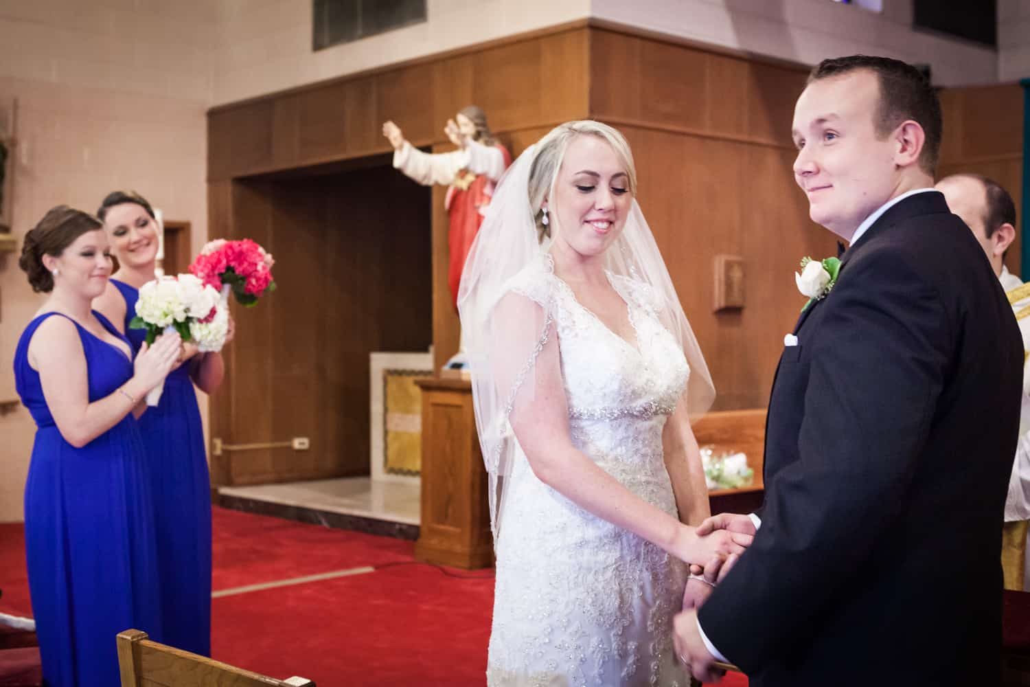 Bride and groom exchanging vows during Staten Island wedding ceremony