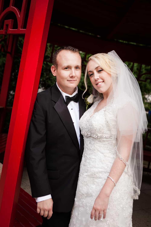 Bride and groom under Japanese gazebo at a Nicotra's Ballroom wedding
