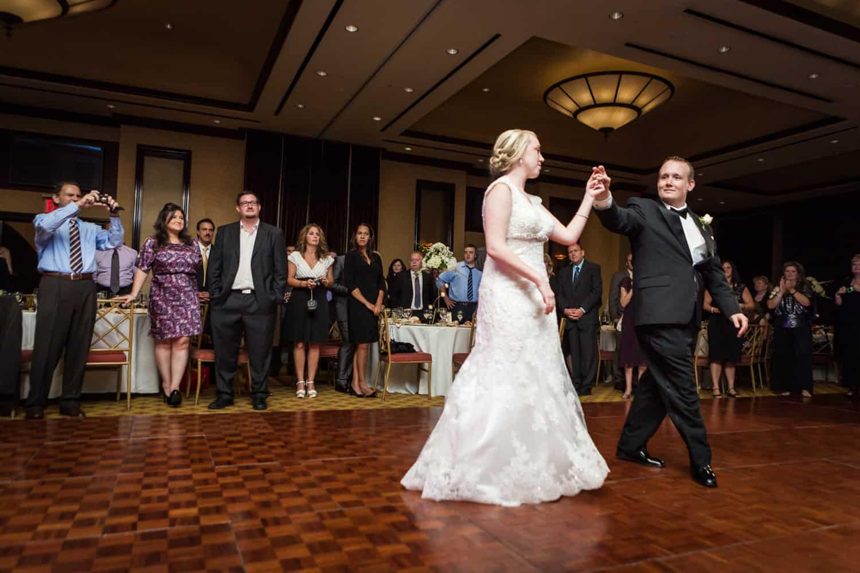 Groom leading bride on dance floor at a Nicotra's Ballroom wedding