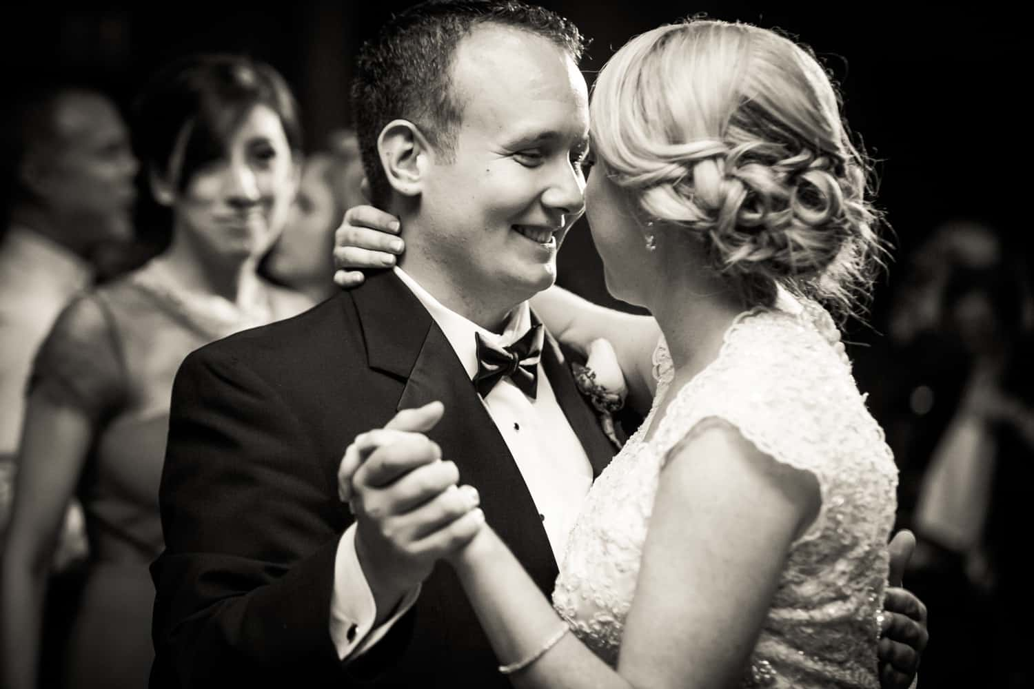 Black and white photo of bride and groom during first dance
