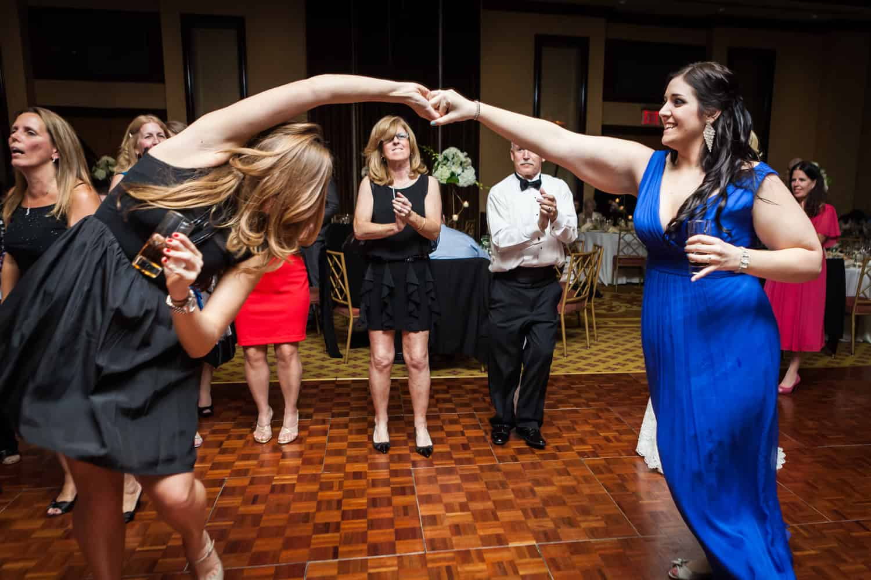 Two women dancing at a Nicotra's Ballroom wedding