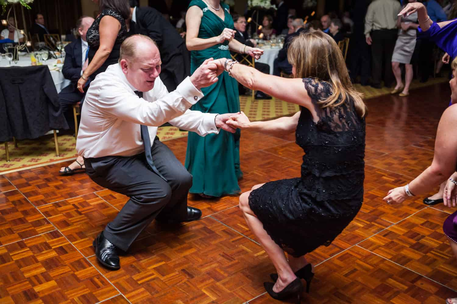 Two guests dancing low to the floor at a Nicotra's Ballroom wedding
