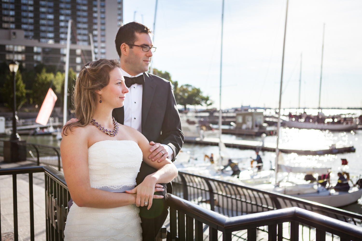 Bride and groom in front of marina at a trash the dress shoot