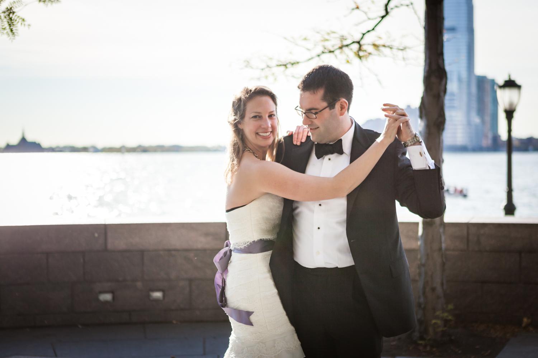 Bride and groom dancing at Rockefeller Park