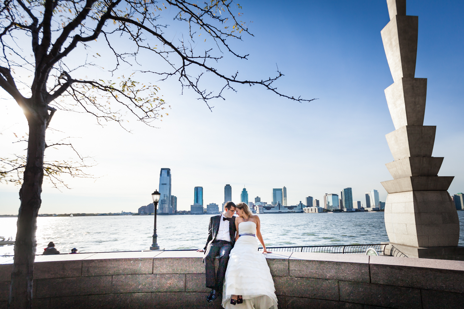 Bride and groom in front of Hudson River waterfront at a trash the dress shoot