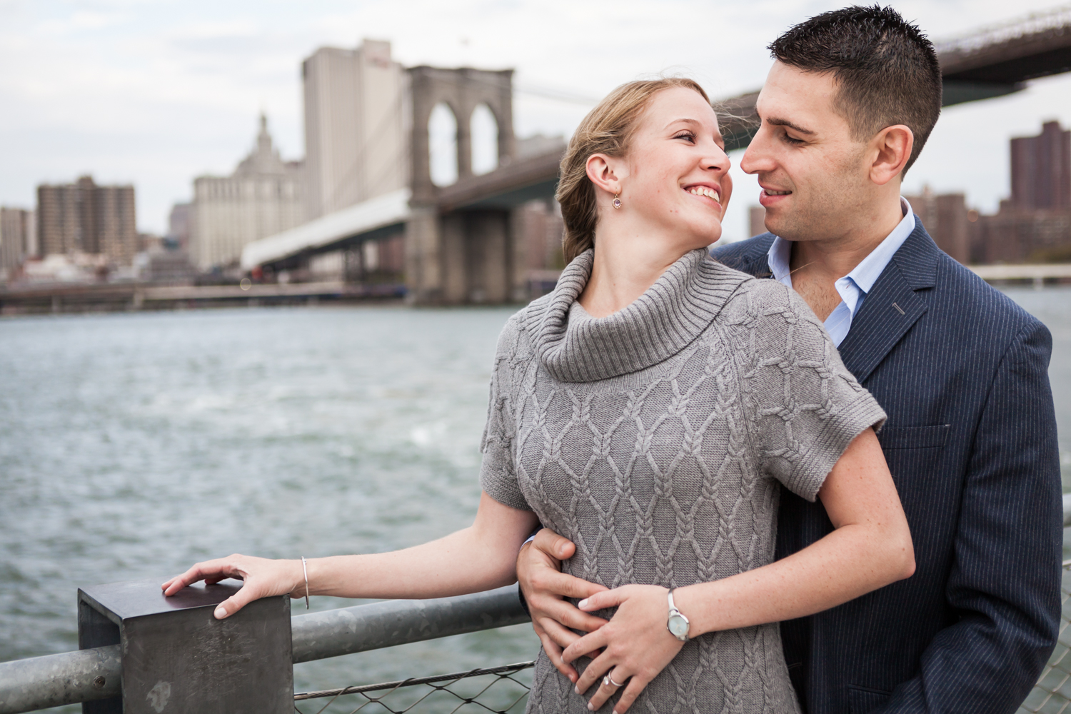 Couple hugging with Brooklyn Bridge in background