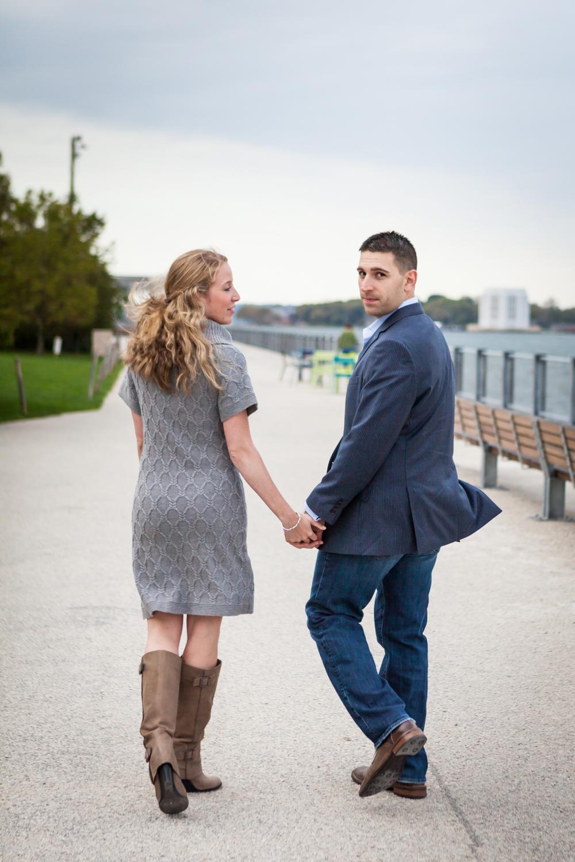 Couple walking along pathway in Brooklyn Bridge Park