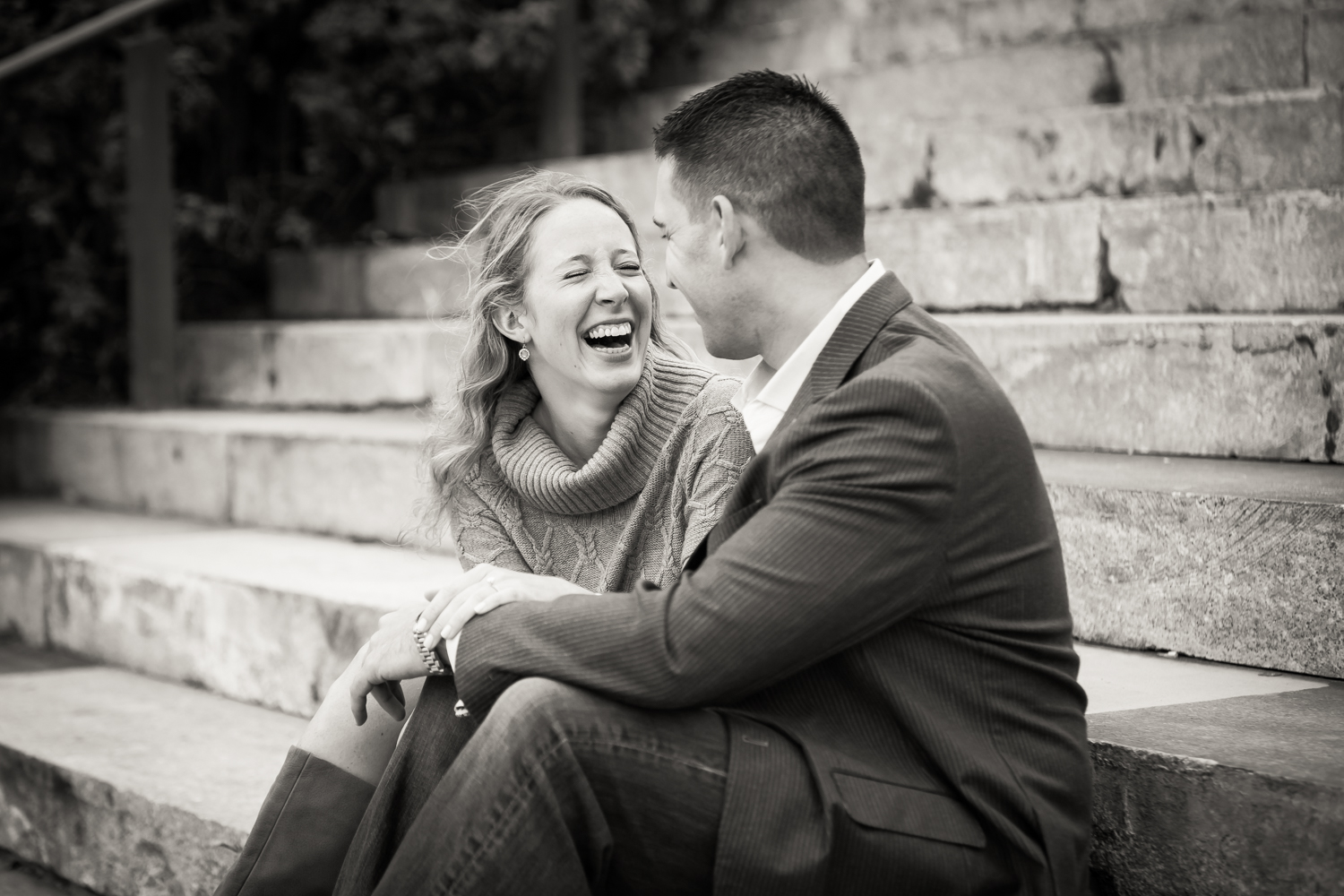Black and white photo of woman laughing with man