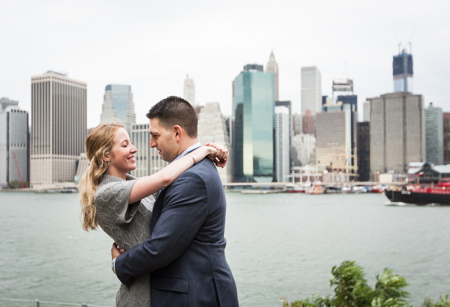 Couple looking at each other with NYC skyline in background