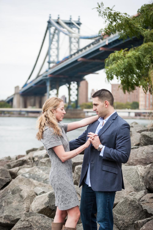 Couple dancing in Brooklyn Bridge Park with Manhattan Bridge in background