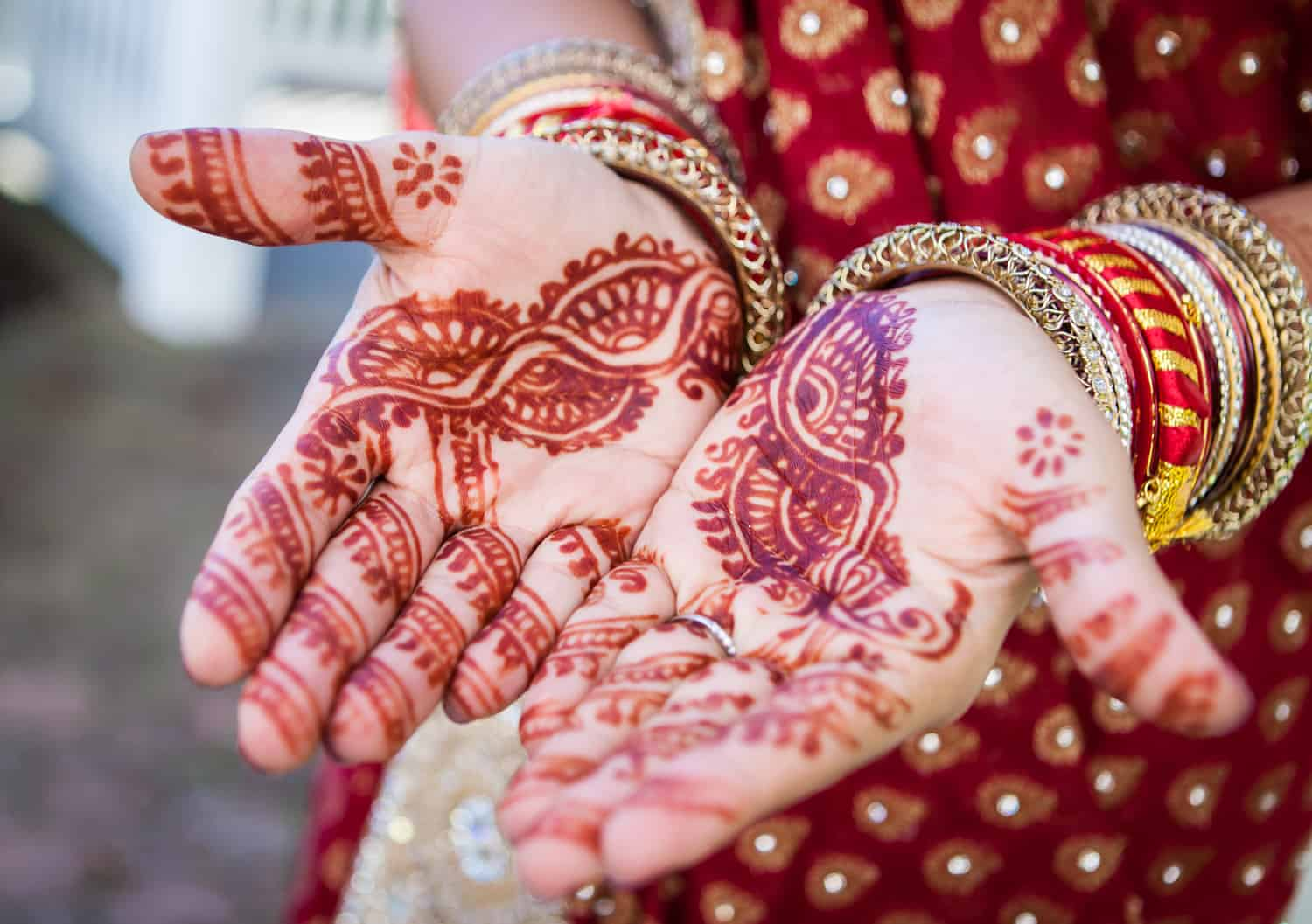Close up on bride's hands with traditional henna design on skin