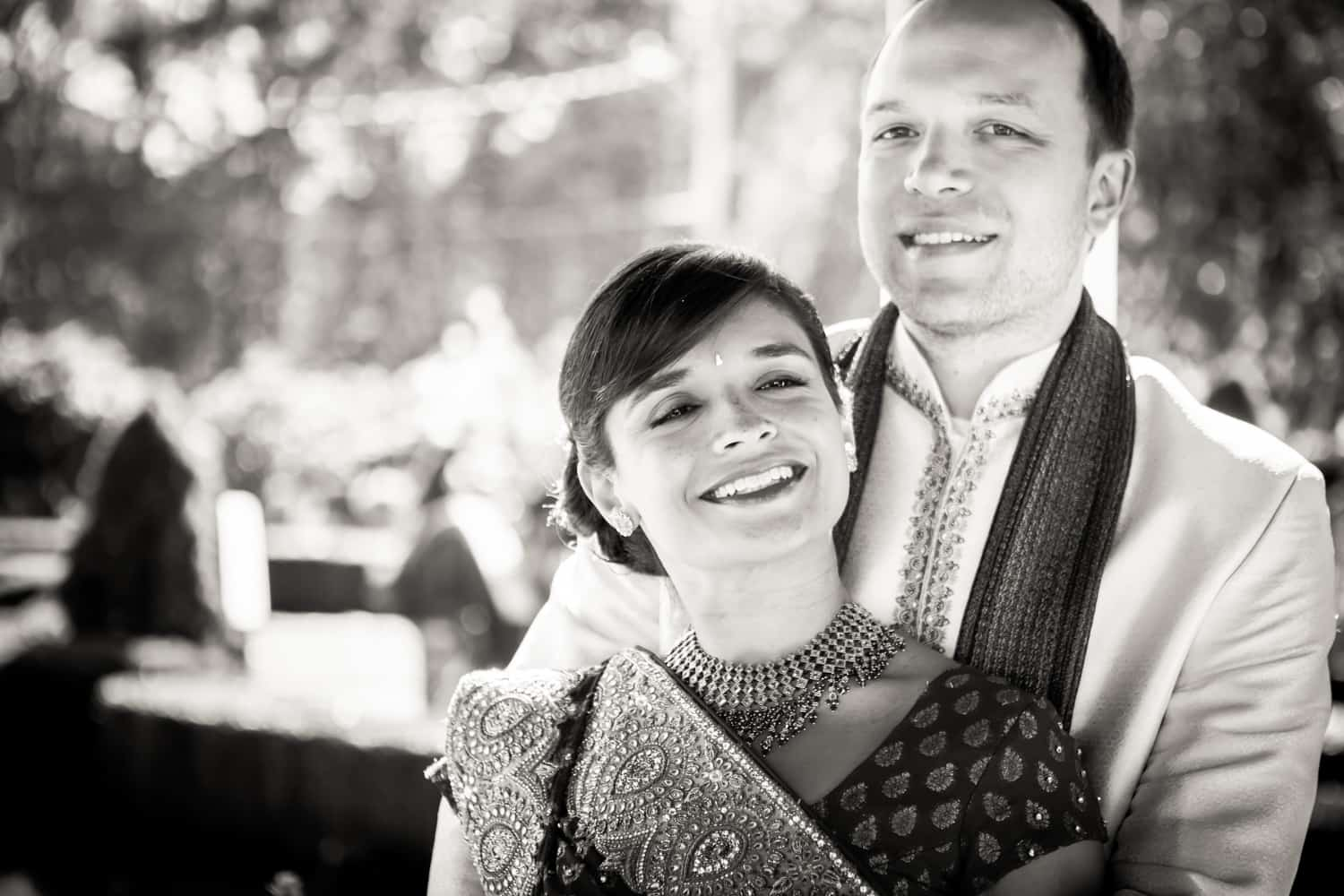Black and white photo of bride and groom wearing traditional wedding attire at an East Wind Inn wedding