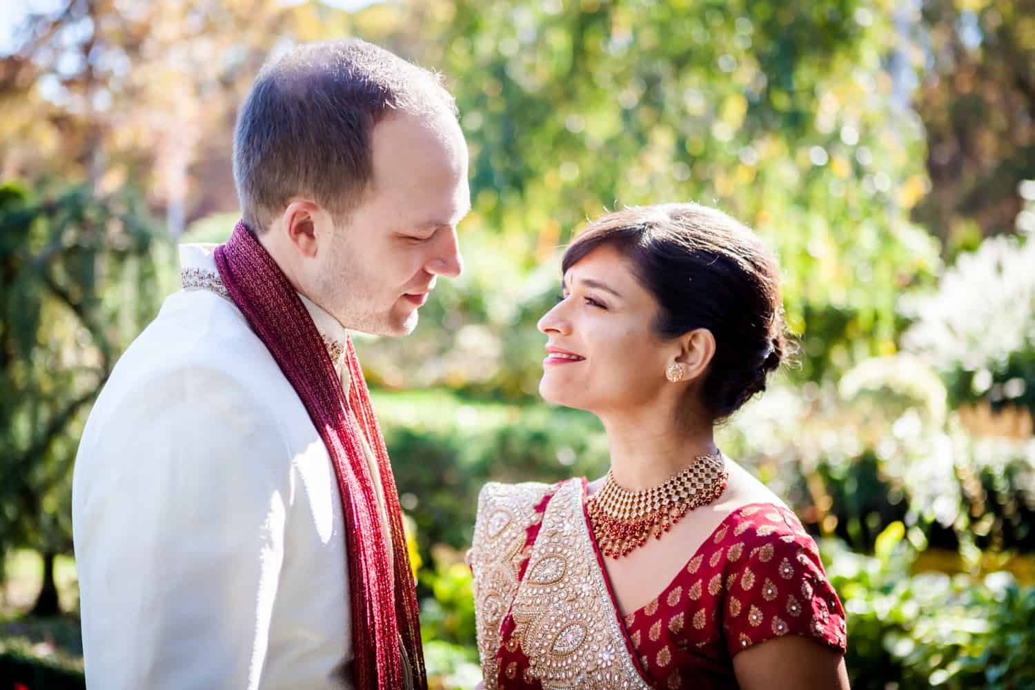 Bride and groom wearing traditional wedding attire at an East Wind Inn wedding