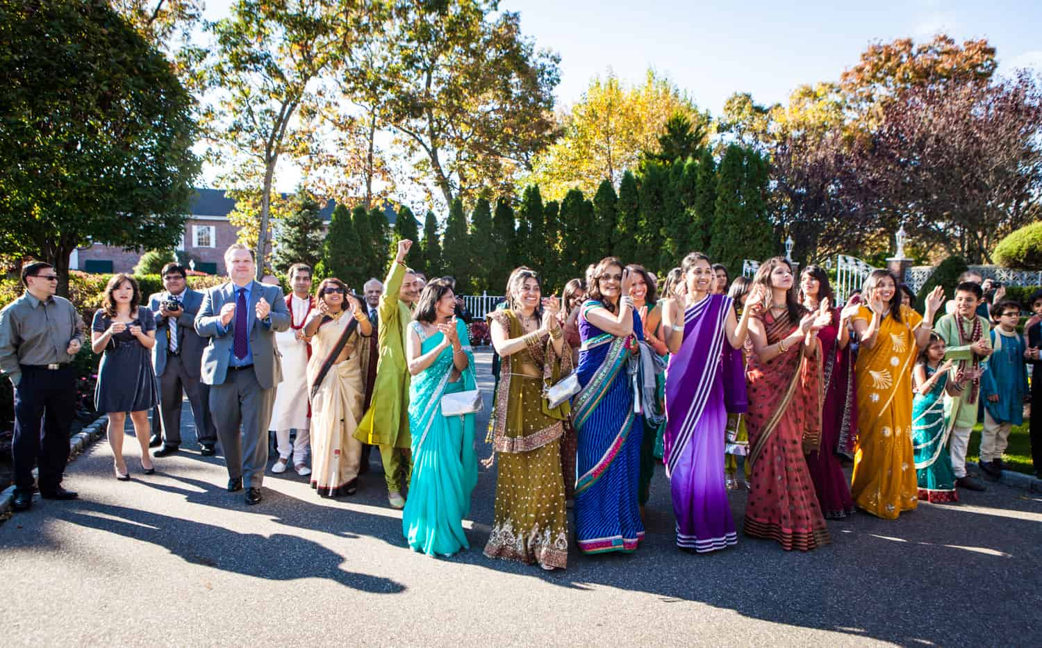 Bride's family members wearing colorful saris at an East Wind Inn wedding