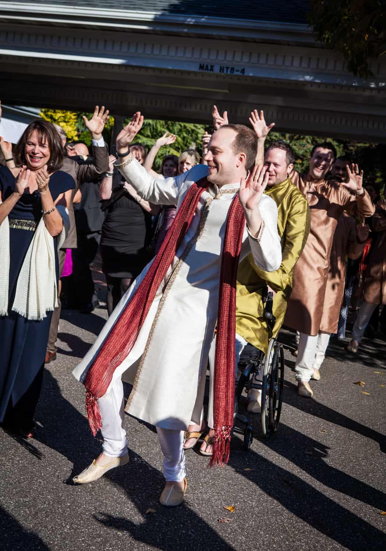 Groom dancing during baraat at an East Wind Inn wedding