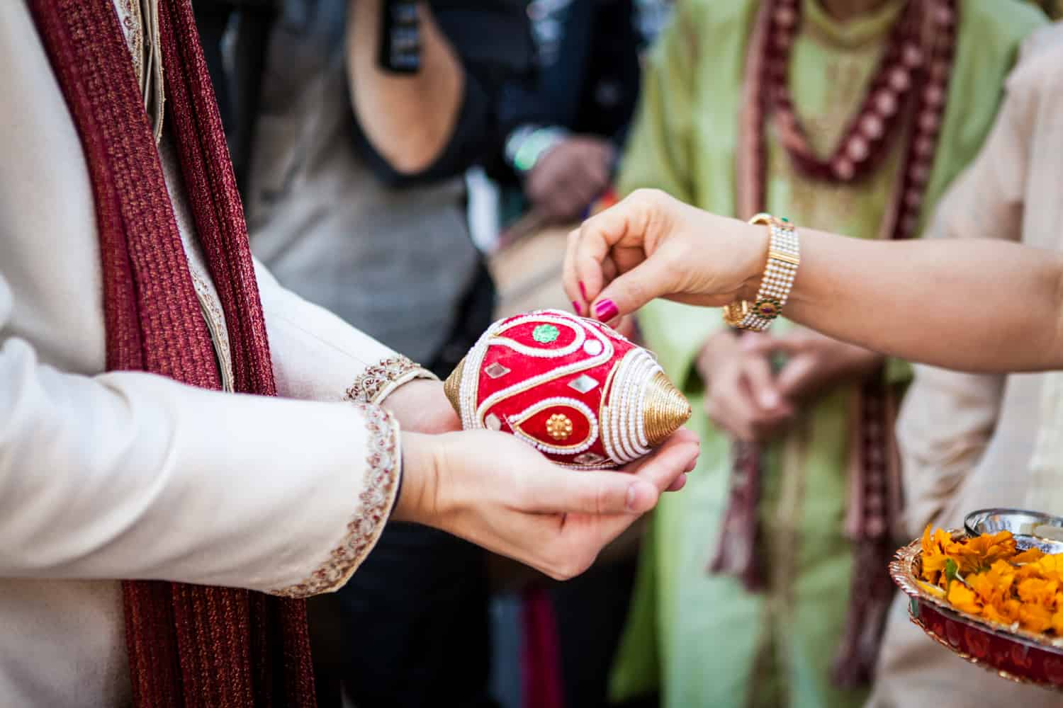 Close up on groom's hands during traditional Indian baraat
