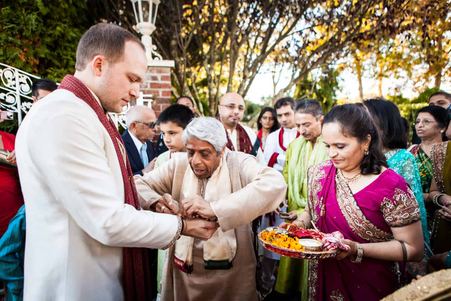 Groom and family members during baraat at an East Wind Inn wedding