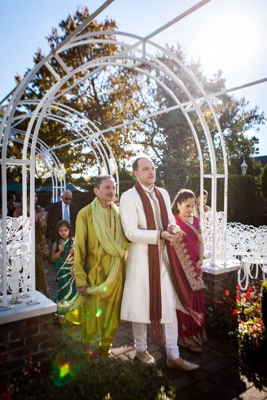Groom accompanied by bride's parents at an East Wind Inn wedding