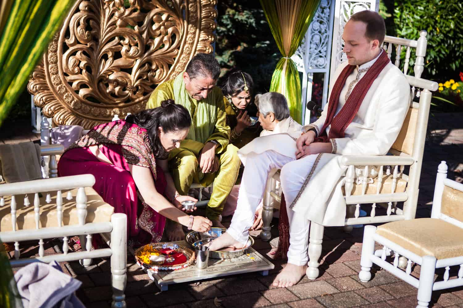 Mother of bride attending to feet of groom at an East Wind Inn wedding