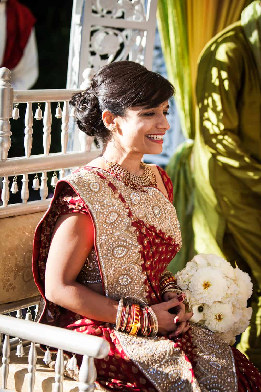 Bride smiling during traditional Hindu wedding ceremony