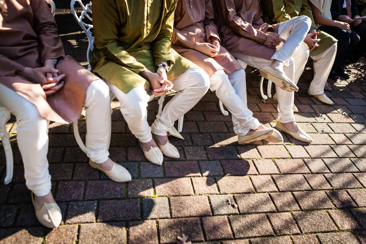 Close up on traditional Indian footwear of groomsmen