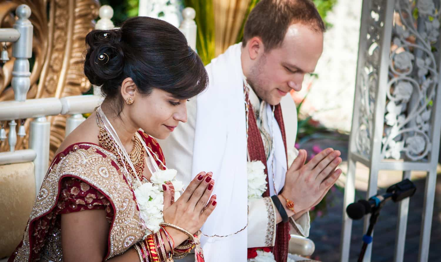 Bride and groom praying during traditional Hindu wedding ceremony