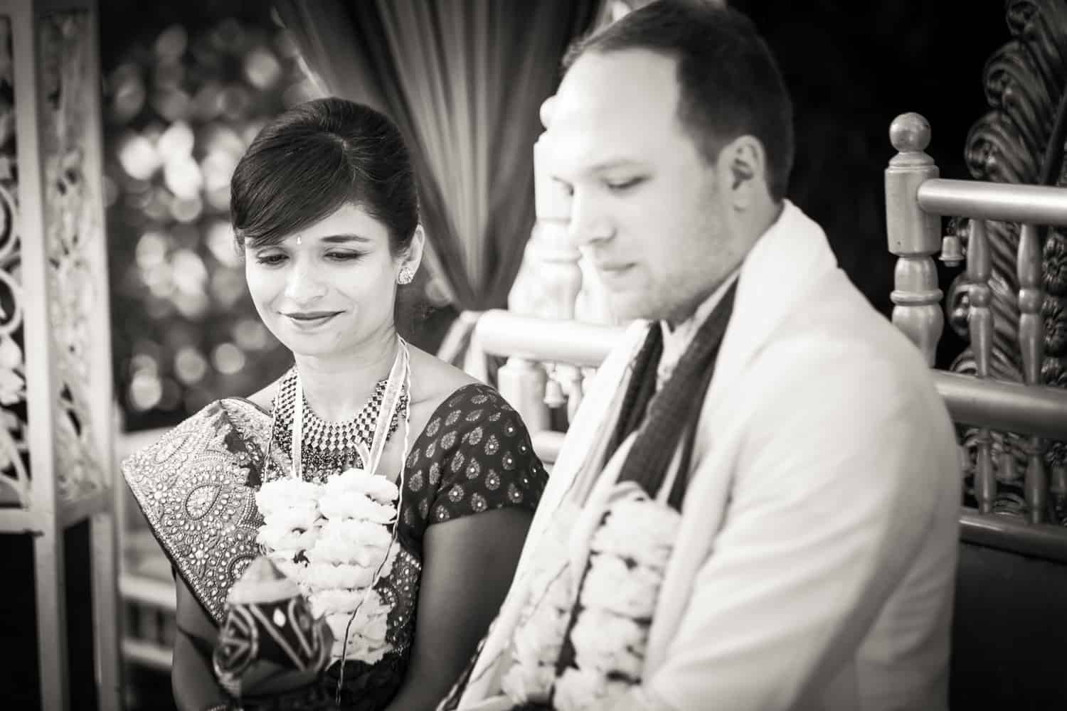 Black and white photo of bride and groom during traditional Hindu wedding ceremony