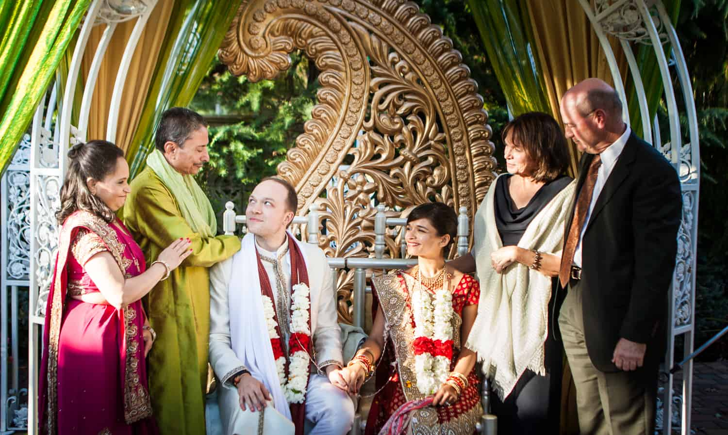 Parents speaking to bride and groom during traditional Hindu wedding ceremony