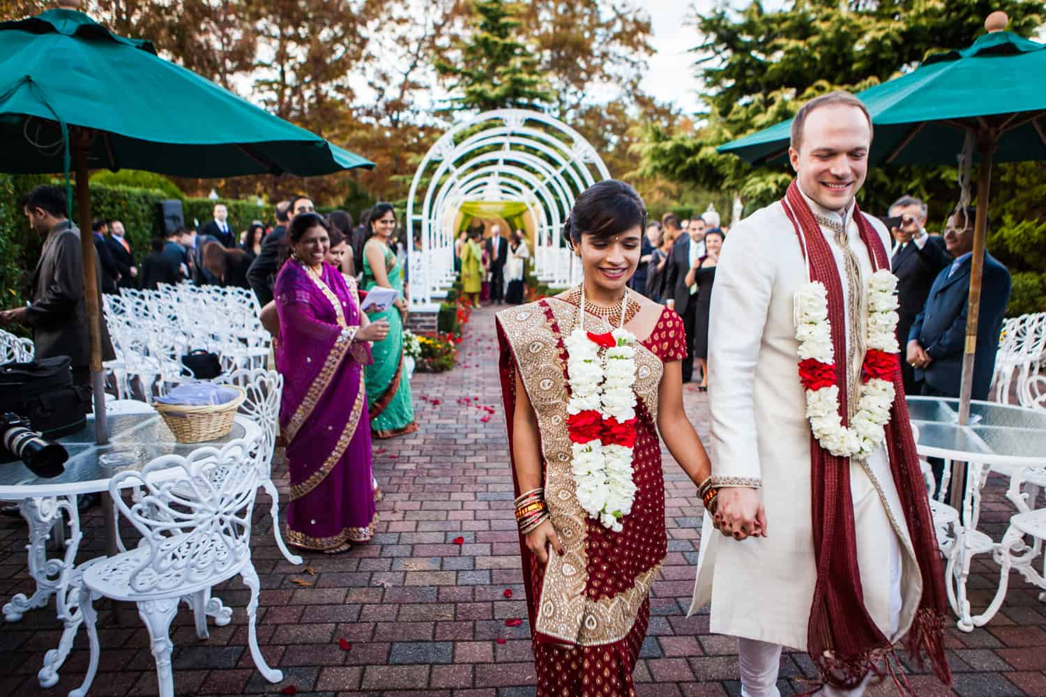 Bride and groom recessing after traditional Hindu wedding ceremony at an East Wind Inn wedding
