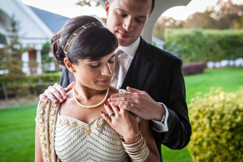 Bride and groom admiring wedding rings