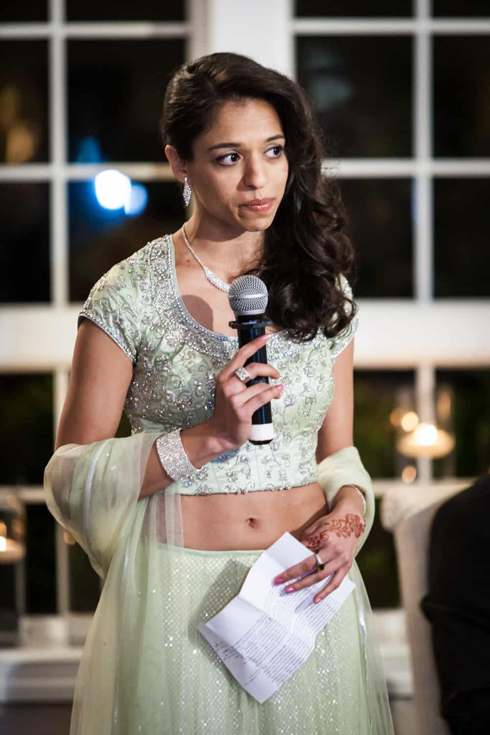 Maid of honor making speech in Indian traditional sari at an East Wind Inn wedding reception