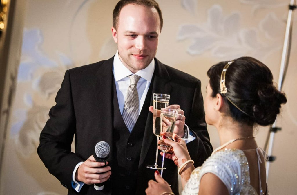 Bride and groom toasting champagne glasses at an East Wind Inn wedding reception